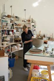Alice Corbett working from home in her ceramics studio